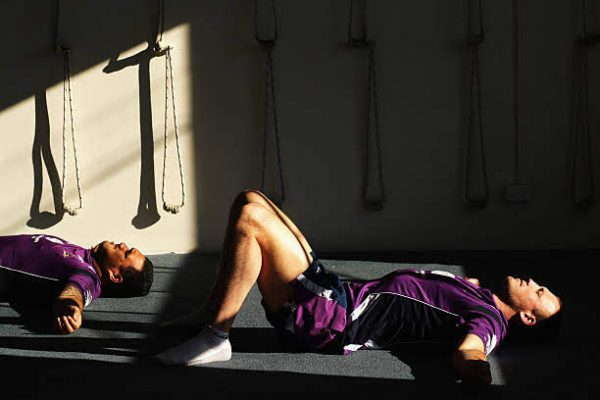 MELBOURNE, AUSTRALIA - JUNE 22:  Matthew Cross of the Melbourne Storm performs a yoga exercise during a Melbourne Storm NRL recovery session at Bridge Road Yoga Studios on June 22, 2009 in Melbourne, Australia.  (Photo by Mark Dadswell/Getty Images)